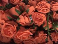 Over 200 burnt orange foam roses