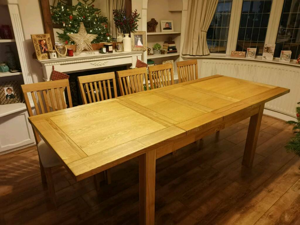 solid oak extending dining table 10-12 halo   in sale