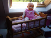 **BARGAIN BUY** dolls wooden swinging crib with 4 handmade 4 piece set and giggling doll