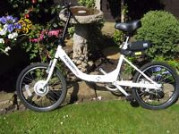"""HOPPER CITY ELECTRIC BIKE. FOR SALE .UNISEX ADULT with 20"""" WHEELS"""