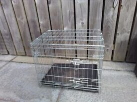 Medium metal dog cage and free new bed