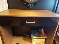 Dark wood desk with single black draw