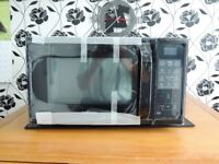 Samsung 900 Watt combination Microwave . Still in box and wrapping. Grill/Convectionoven and micro.