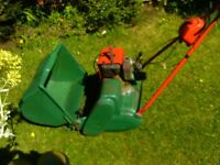 petrol atco lawnmower and qualcast with moss attachment