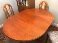 6 seater extending round solid table with 4 chairs