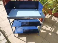 Camping stove stand with wind shield and 2 shelves