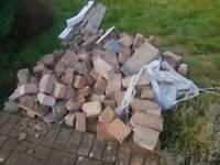 Bricks / rubble and concrete plinth