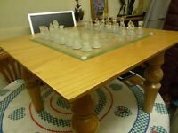 TABLE WITH GLASS CHESS SET,LOVELY TABLE,VERY HEAVY, SOLID WOOD, BARGAIN £25, CAN DELIVER