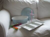 New kitchen items, casserole dish (dishwasher microwave safe), measuring spoons, mug and dish.