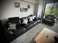 Black Leather 4 seater sofa, extra large arm chair and footstool with storage
