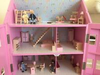 Wooden dolls house with furniture and toy people