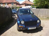 Jeep cheroke, metallic blue, drives great,