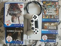 White playstation 4 with controller and 5 games