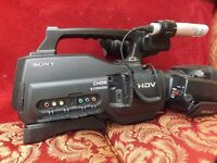 SONY HVR-HD1000E WITH PURPOSE HAND MADE LARGE LEATHER CARRYING BAG AND SPARE BATTERY