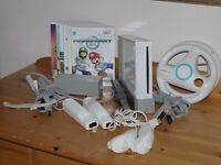 Used Wii. Complete with Balance Board and 6 game discs