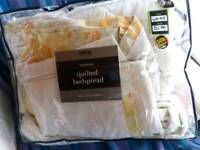 Pretty yellow and white bed quilted bed throw with similar curtain