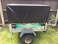 Camel trailer with high mesh side