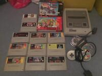 Snes boxed with 13 games and 2x controllers