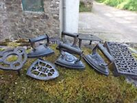 Quantity of antique flat irons and trivets