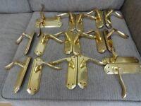 Brass door handles for interior doors.