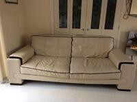 DFS leather 3/4 sofa biscuit beige in colour.