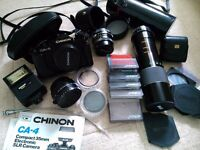 Classic Chinon CA-4 35mm SLR camera with various lenses and accessories