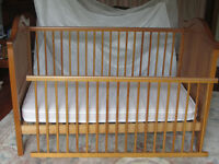 Childs cot / bed. Includes mattress and linen.