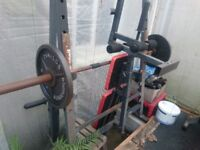 OLYMPIC POWER BENCH, COMMERCIAL LEG PRESS, LAT MACHINE, ABDOMINAL MACHINE, DUMBBELLS, RACKS & PLATES