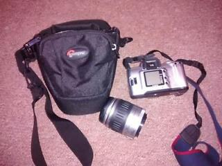 Canon eos rebel ti, with 28-90 mm lens, with some filters. mint condition.