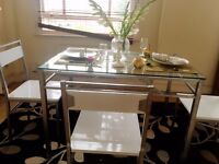 Modern glass top steel base dining table with chairs set. Seat up to 8