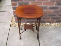 An attractive Edwardian table with inlay.