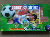 Vintage Super Striker football game with real kicking action. 100% Complete with original balls.