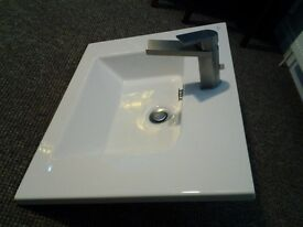 Porcelanosa wash hand basin with stainless steel mixer tap