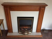 Wood fireplace with electric fire
