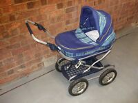 Childs Mamas & Papas dolls pram for sale. Local delivery may be possible. Folds down for easy store.