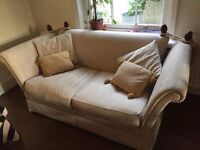 Lovely beige two seater sofa that converts into single bed