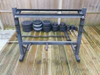 135kg of weights + Weight rack + 4x Dumbbells + 1 EZ-Bar + 1x Barbell