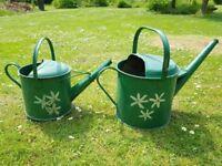 Genuine old garden metal watering cans