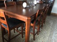 8 seater solid dining table & chairs