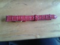 Watch strap, lady's, red tooled leather, gold buckle, good as new