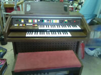 JVC organ (44 inches wide, 38 inches tall, 23 inches deep) in full working order with a stool