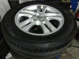 215 70 16 / 225 65 17 tires / OEM Honda CRV alloy and steel rims 5 x 114.3 in stock