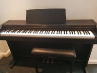Roland Piano RP101 with piano stool, hardly used and in great condition!