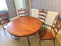 Circular wood table with 4 chairs