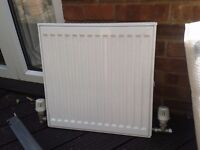 Small new radiator, never used, inc wall brackets 20 x 20""