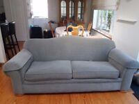 Large olive green sofa