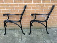 Two cast iron seat or bench ends in mint condition