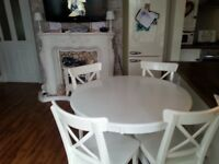 Dining table and 4 chairs good clean condition can also deliver to your address