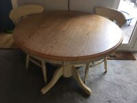 Circular solid wood table and 2 chairs