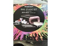 Brand new in box nail studio with uv lamp /277 piece set